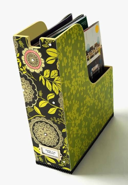 Decoupage magazine holder.