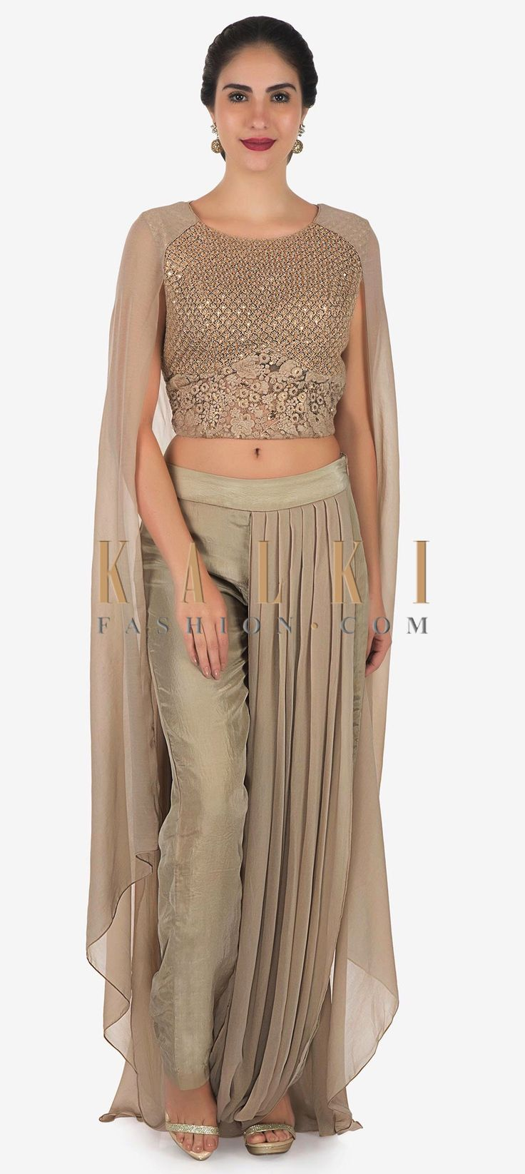 Buy Online from the link below. We ship worldwide Click Anywhere to Tag Palak Tiwari in Kalki grey crop top with drape palazzo suit with fancy cape ‌Featuring grey crop top in net embellished in resham and sequin embroidery. Matched with drape palazzo pant in georgette. It comes with fancy attach batman sleeve at the shoulder in georgette. Celebrity- Palak Tiwari. Slight variation in color is possible.
