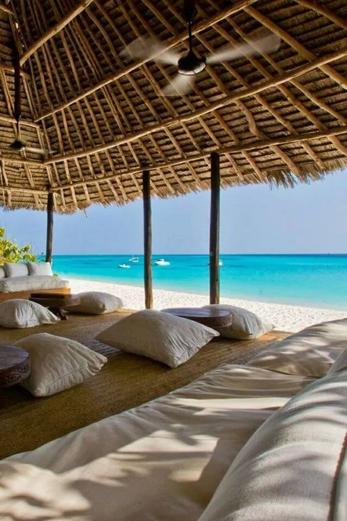 The beach is calling your name |  beach cabana | luxury living | white sand and blue water