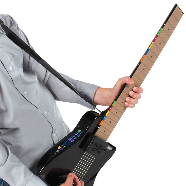 The Instant Rock Star Guitar - Hammacher Schlemmer - With six strings that never need tuning and a touch-sensitive electronic fretboard that recognizes actual chords, players can execute soaring tremolo-bar dive bombs, hammer-ons, and legato tapping for all the nuanced realism expected of any rock star diety.