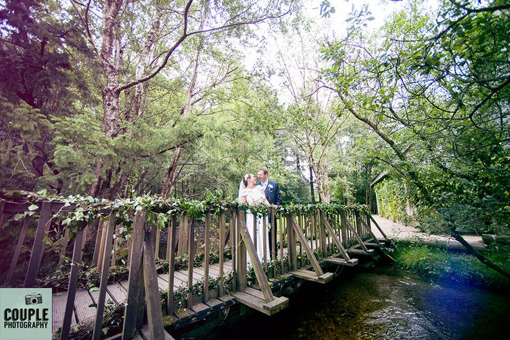 Epic wide angle shot of the couple on the bridge at Brooklodge. Wedding photography at The Brooklodge Hotel by Couple Photography.
