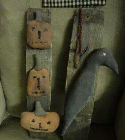 Prim Fabric Pumpkins on a Board Alongside a Crow