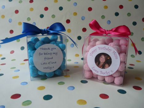 PERSONALISED SWEET CUBE A lovely clear cube which can be filled with your choice of sweets. Your sweet cube can be personalised with a favourite photograph/picture or your choice of wording on a high gloss round label attached to the front of the cube. This makes a gorgeous gift for any occasion. You can choose up to 5 varieties of sweets you like from our range to go in your cube. Each cube holds approximately 500g of your pick and mix favourites.