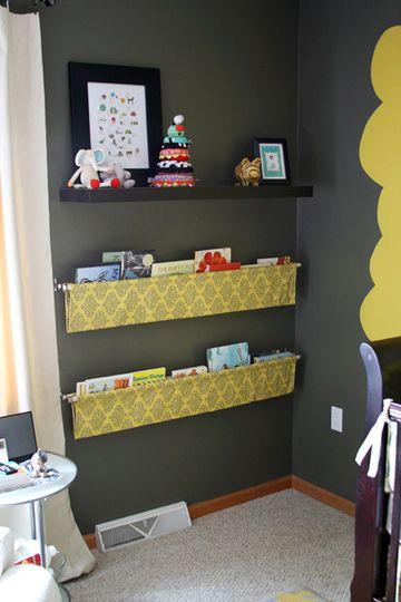 fabric with curtain rod hanging book shelves. GENIUS.