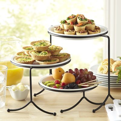 How to assemble a bountiful buffet? Divide and conquer with the help of this three-tier server. The white porcelain plates sit securely atop a black metal base and allow you to create a waterfall effect when filled with fruits, meat, bread, crackers or bite-sized desserts. Cleanup is a breeze since the plates are dishwasher safe.