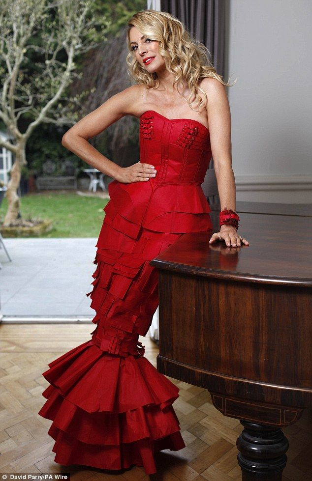 Red alert: Tess Daly posed in a stand-out gown made from 600 dyed DYLON Colour Catcher sheets in a new shoot