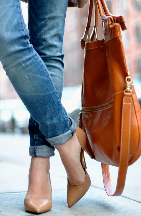 the rolled up skinny jeans with heels. and bright bag.