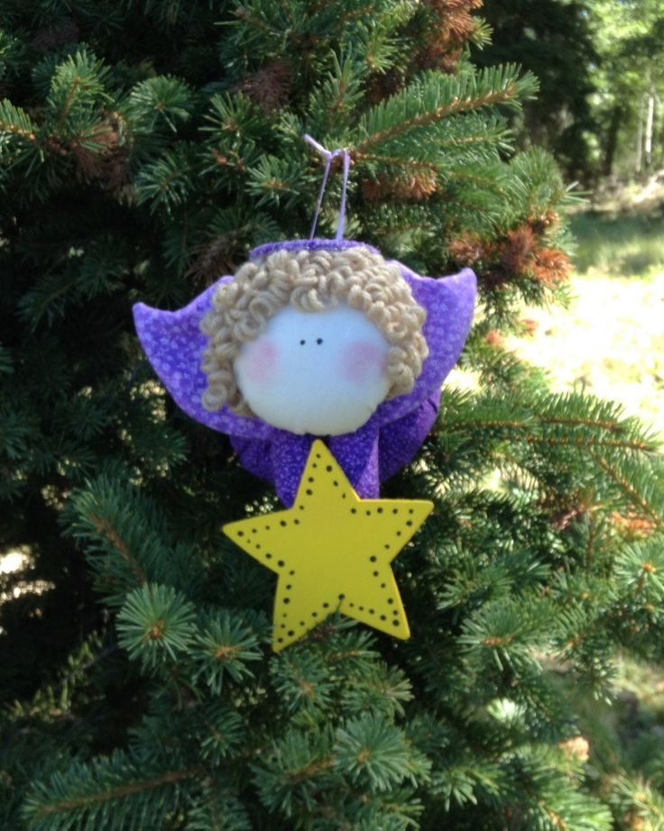 Primitive Sandy Blonde Angel with  Purple Body and Purple Wings holding a Star…
