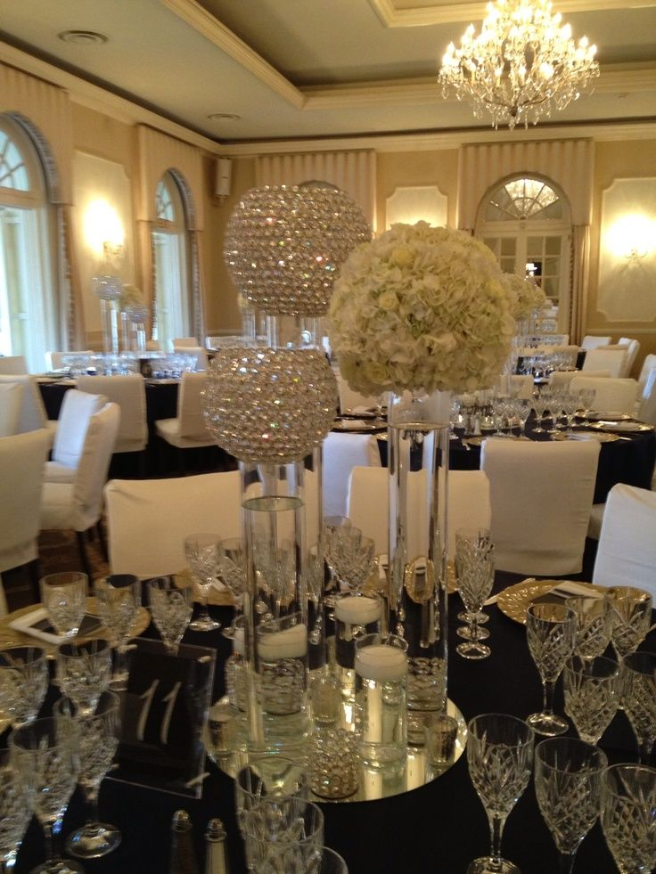 centerpieces for wedding receptions with candles%0A Love all the crystal mixed with tall floating candles