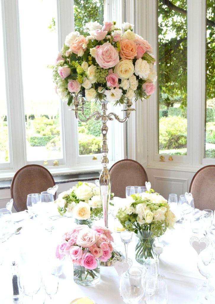 Best 10 candelabra flowers ideas on pinterest wedding for Wedding reception centrepieces