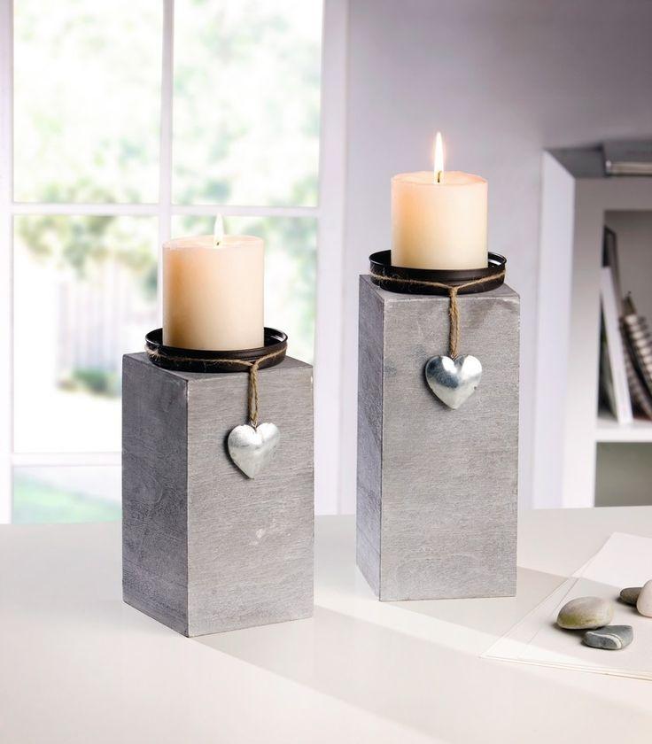 schlicht romantisches Design, grau lackiertes Holz, Kerzenteller aus Blech, dekoriert mit Schnur und kleinem Blechherz in schimmerndem Silber