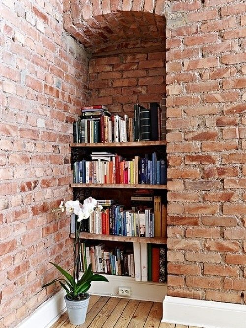 brick walls + bookcase.