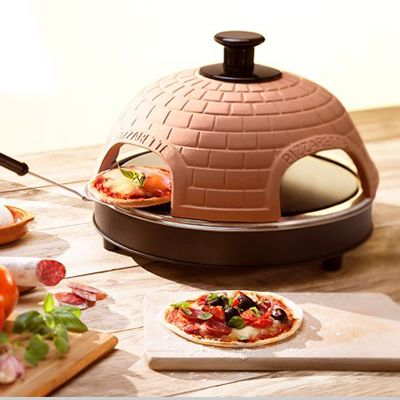 Cook pizzas at the dinner table with this fun Tabletop Italian Pizza Maker by Global Gourmet. The authentic stone oven cooks pizzas in under 10 minutes.
