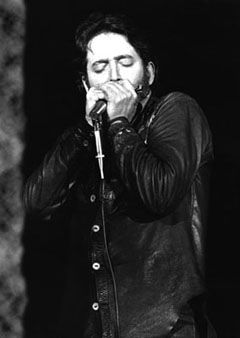 Paul Butterfield. Every time I hear Mystery Train  his harmonica playing just makes me tingle!
