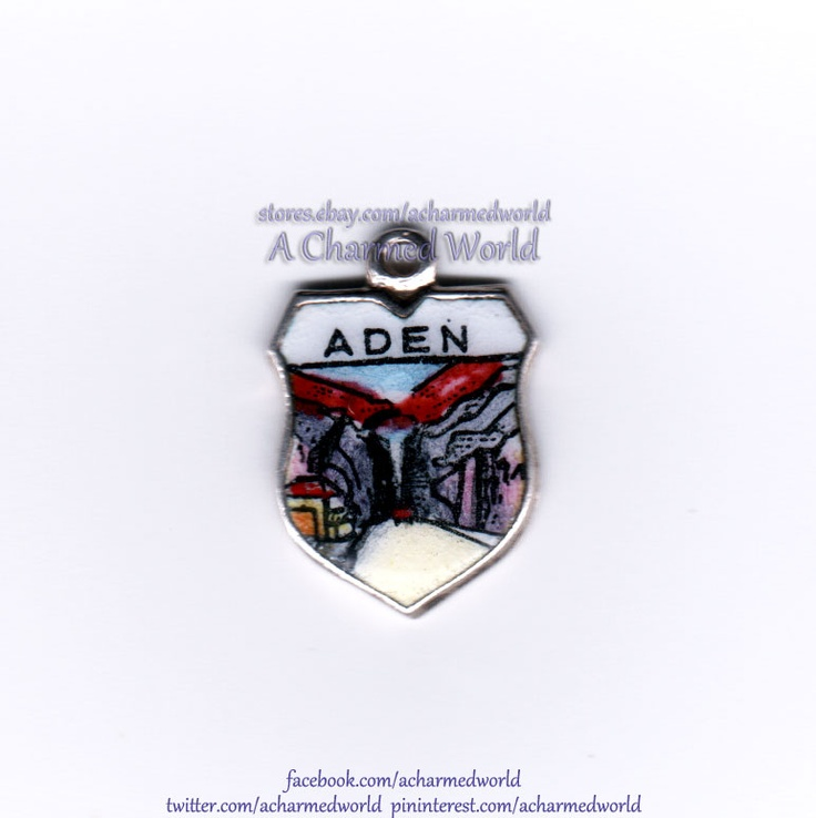 Vintage Enamel Silver Seera Kraytar Aden Yemen Shield Charm - $34.95  This stunning vintage shield charm is for Aden, a seaport city in Yemen. It features a fascinating painting of the Kraytar (or Seera, officially) distrcit of Aden. The historic Seera District is located in the crater of a long extinct volcano. The charm is made of hand-painted enamel on European silver, measures roughly 5/8 inch x 7/16 inch and is in excellent vintage condition.  <a…