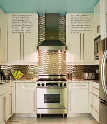 Use a metalic backsplash to blend modern with traditional style to make a kitchen that is all your own