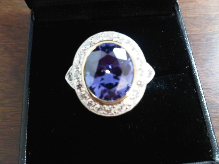 Argentium 960 Silver Ring, set with a Tanzenite Cubic Zirconia in a 9ct Yellow Setting, and small white cubic zirconias.