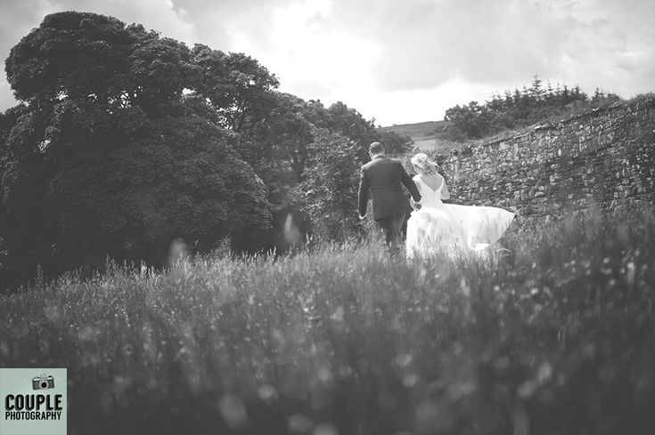 Moody black & white photo of the bride & groom as they head for a stroll. Weddings in Mayo, Photographed by Couple Photography.