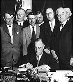New Deal: President Franklin D. Roosevelt signs the Tennessee Valley Authority Act, 18 May 1933