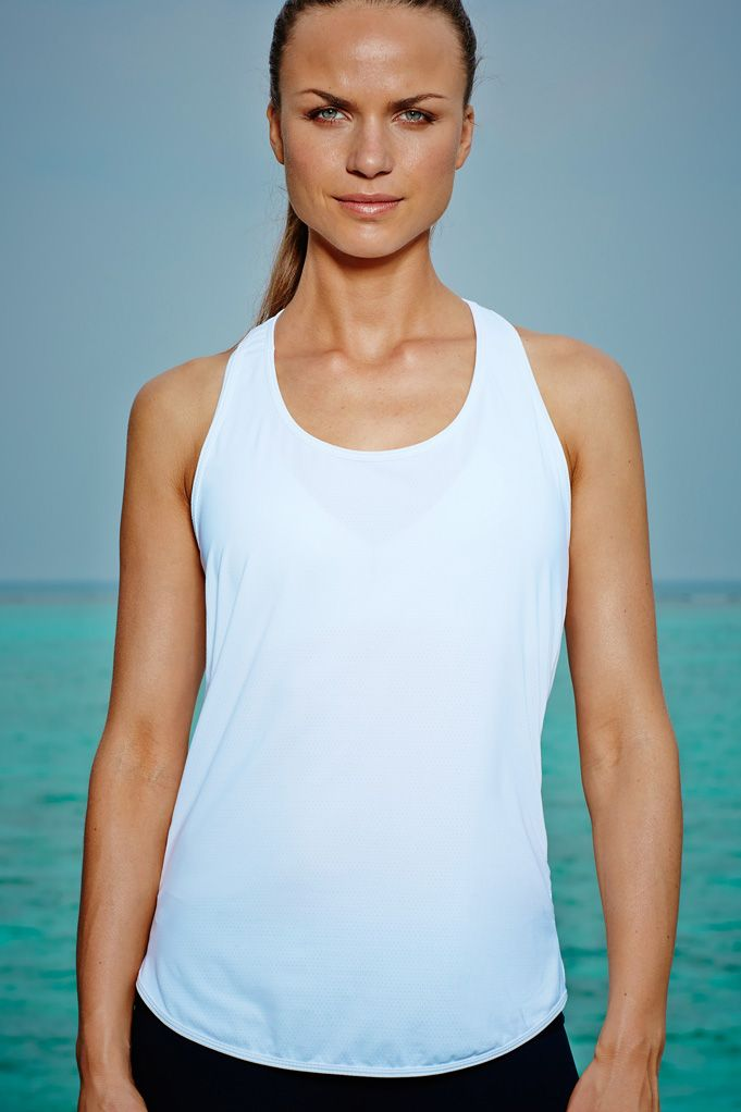 Sophia Top – SS15 - White Available in Blueor White. For a more lightweight, breathable fabric alternative, the Sophia sports vest is ideal for cardio-intensive workouts. The intelligent mesh fabric provides added ventilation whilst the scoop neck and slim-fit body flatter the silhouette.  Available now, £60.00 at http://www.bodyism.com/product/sophia-top/