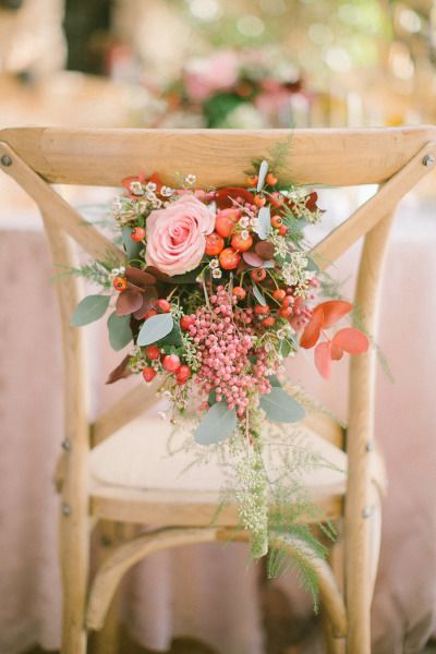 Winter wedding flowers decorate the table chairs: http://www.stylemepretty.com/little-black-book-blog/2014/12/22/boho-chic-winter-wedding-inspiration/ | Photography: Anna Roussos - http://www.annaroussos.com/