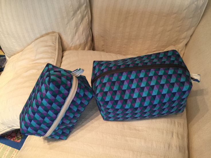 boxed zipper pouch in two different sizes
