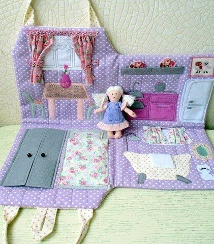 Felt Doll house for Jose and Maria...basic rooms: kitchen, bedroom, bathroom, living room. Back can be yard (for seasons/weather?)