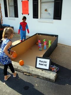 More kids Halloween games, cute idea with the refrigerator box for the bowling lane