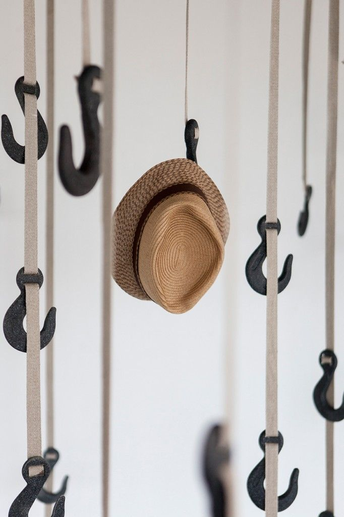 The Grapple Hanging System by Ryan Frank, suspension storage uses crane  hook-inspired hangers made of Agriplast, a green formula requiring a small  amount of