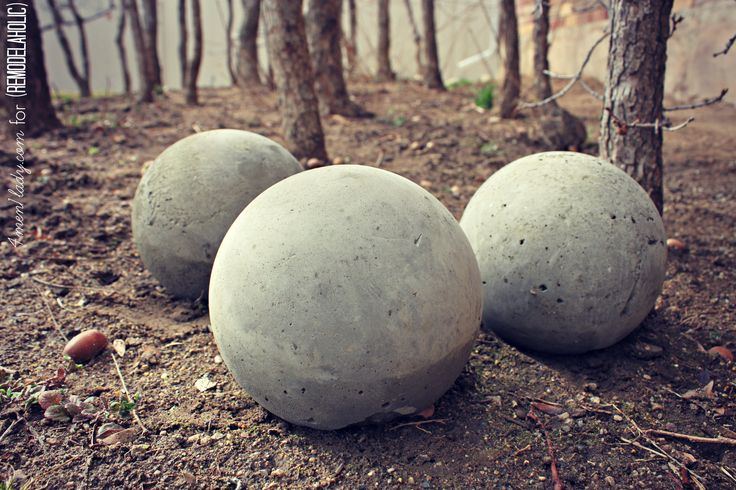 DIY Cement Garden Globes with instructions. By: 4men1lady featured on Remodelaholic.