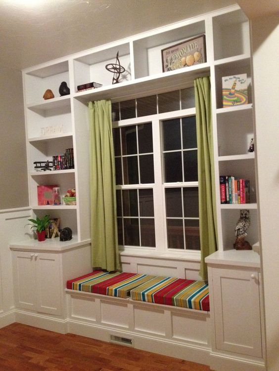 Built in bookshelves around the window with a seat for daydreaming.: