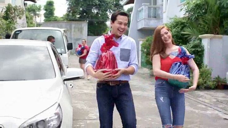 """This is the handsome John Lloyd Cruz (Popoy) and the pretty Bea Alonzo (Basha) preparing to give away Christmas gifts to the staff and crew of their film, A Second Chance, during the taping of the ABS-CBN 2015 Christmas Station ID, """"Thank You for the Love!"""" Indeed, John Lloyd and Bea are kind and helpful. #JohnLloydCruz #BeaAlonzo #PopoyandBasha #ASecondChance #ABSCBNChristmasStationID #ThankYoufortheLove"""