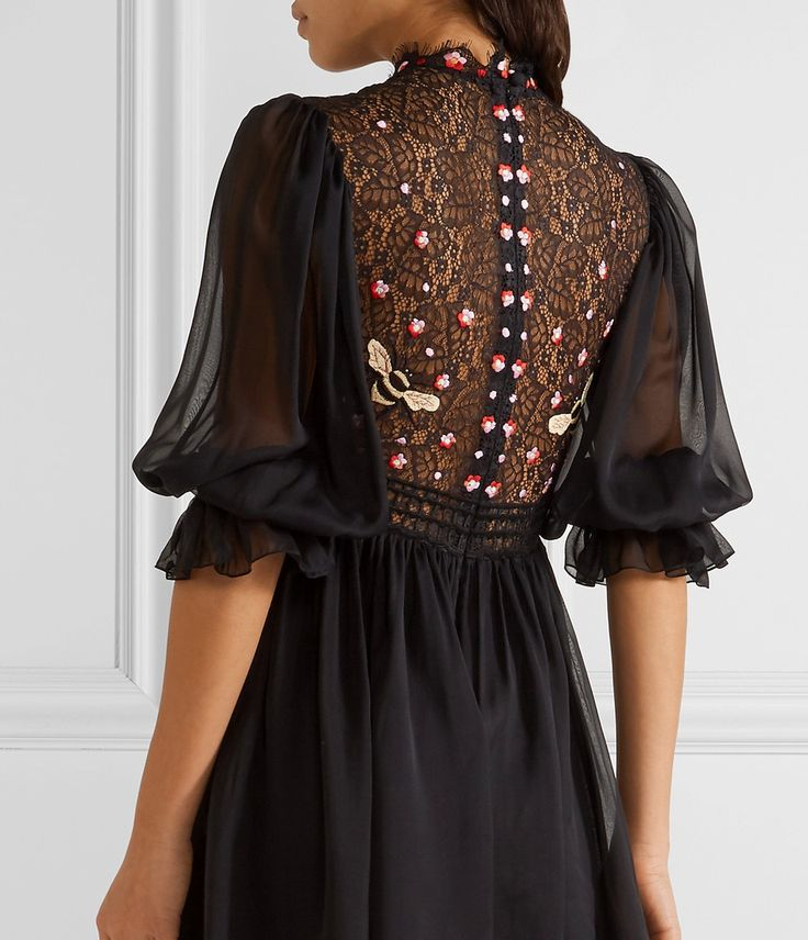 The Mini Aura Lace Dress features a Lace embroidered bodice and billowing silk sleeves