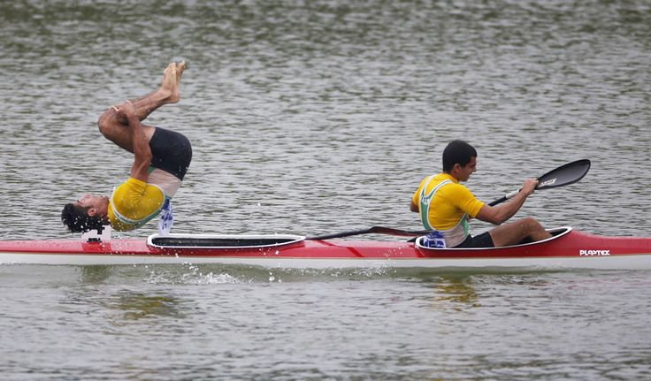 Iran's Saeid Fazloula jumps into the water after he and teammate Ali Aghamirzaeijenaghrad finished second in the men's kayak double (K2) 1000m final sprint event at the Hanam Misari Canoe/Kayak Centre, during the 17th Asian Games in Incheon