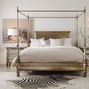 An exquisite blending of silver and gold, the champagne-colored metallic finish of the chic and regal Jus Poster Bed is cause for celebration.<br><br><b>Features: </b><ul><li>Canopy bed</li><li>Champagne-colored metallic finish</li><li>Hardwood Solids and Silver Leaf</li></ul><b>Dimensions: </b><ul><li>Queen: 67 1/2 x 88 1/2 x 82 H</li><li>California King: 92 1/2 x 84 1/2 x 82 H</li><li>King: 84 3/4 x 90 3/4 x 82 1/4 H</li></ul>