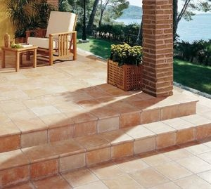 Terracota patio with brick columns. Natural tiles. Timeless.
