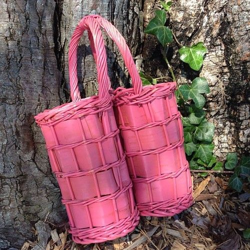 Enjoy your wine outdoors with this pink wicker holder. Fits 2 bottles, very sturdy and easy to carry. $16 #tulipco - @tulipco