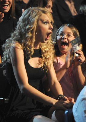 My favorite thing about this photo is the little girl next to her that's just so excited she won, just like Taylor #SwiftysareproudofTaylor