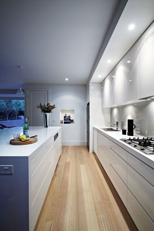 Timber floors, white kitchen & grey glass splash back. Love the handle free draws