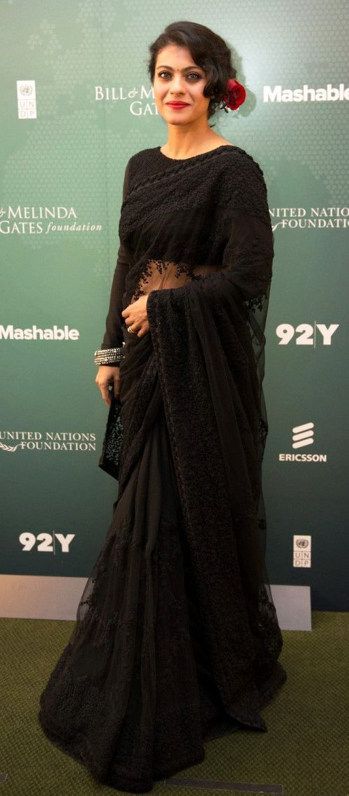 Kajol in a stunning black Sabyasachi sari. Shop for the perfect reception sari for your mother or mother-in-law with a personal shopper & stylist in India - Bridelan, visit our website www.bridelan.com #Bridelan