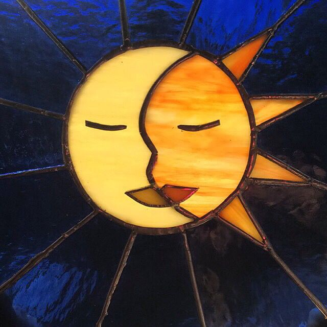Stained glass sun/moon  By Sophie Silvestro