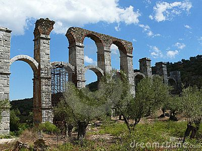 Roman aqueduct between olive trees. Lesvos. Greece by Mangojuicy, via Dreamstime