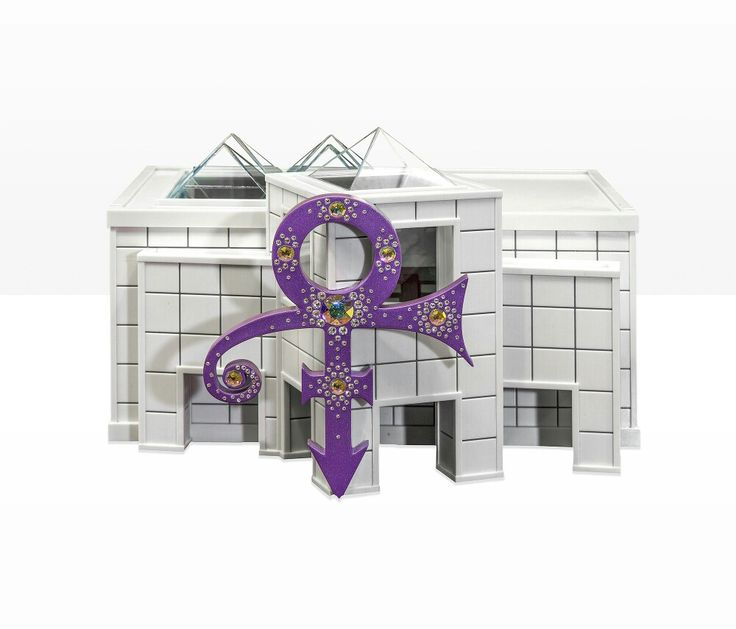 Prince's Legacy Piece on display at Paisley Park Museum. Prince's ashes are sealed inside the front column while the back portion is a replica of Paisley's atrium with a Yamaha piano included. Prince's sister, Tyka, and nephew, President, designed the Legacy Piece.