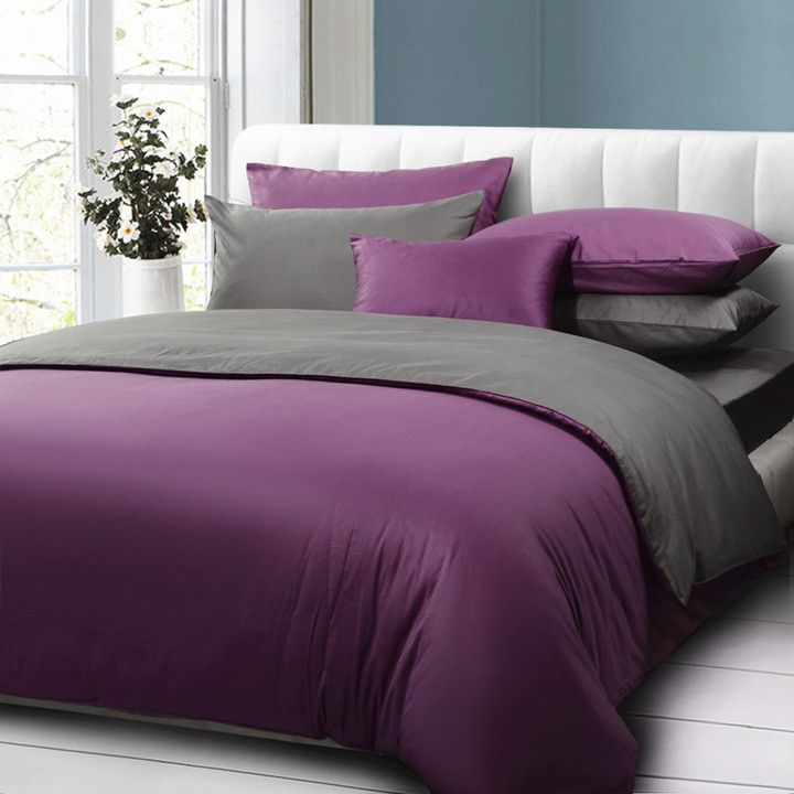 White headboard paired with cool gray and lush plum bedding