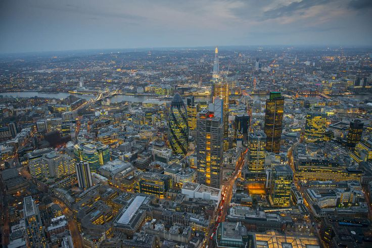 Looking out across the City, with Heron Tower in the foreground, Tower Bridge and the Shard in the background.  21 Dizzying Aerial Photos Of London