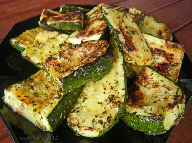 Quick BBQ Zucchini from Food.com:   Another quick and tasty way to do vegetables on the BBQ. No need to measure ingredients but don't go overboard on the herbs.