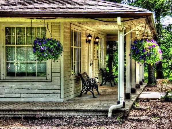 Cottage Porch Art Print by Leslie Montgomery.