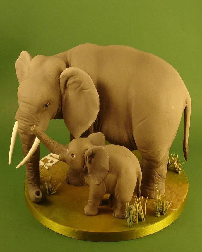 I am really not sure if these are sculpted cake or gumpaste. They are made by Danni's Cakes and I think they are fabulous work.