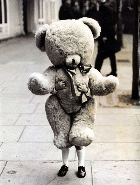 Repin; I love this picture because at first all you see at first is the massive walking teddy bear. it isn't until you look closer that you notice the little hands holding up the bear. A very precious picture that seems to exude innocence.