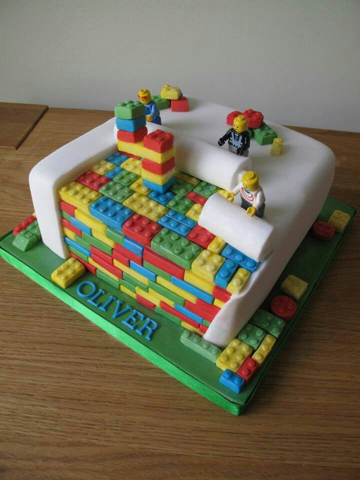 hahaha... i love how the name on this cake is oliver. its ment too be one of his cakes for sure..Lego cake with bricks being covered with fondant by mini figures
